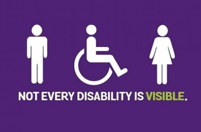 Image of man, woman and wheel chair user